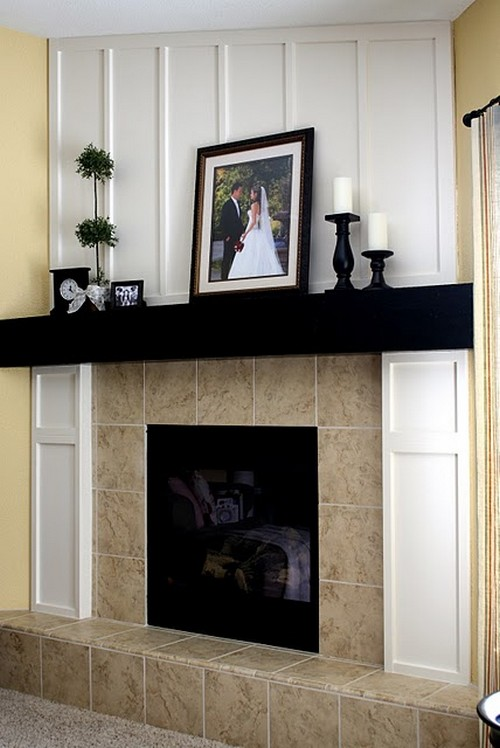 and wow it is with the addition of molding for a board and batten look and a snazzy black mantel piece this fireplace demands attention - Black Fireplace Mantels