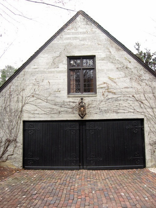 Cobble stone driveway and arched garage door french for French garage doors