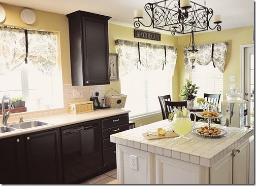 she s gone black in the kitchen on the cabinets and with yellow
