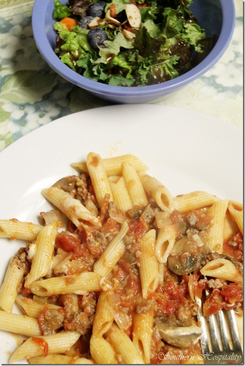 Pasta dish and salad