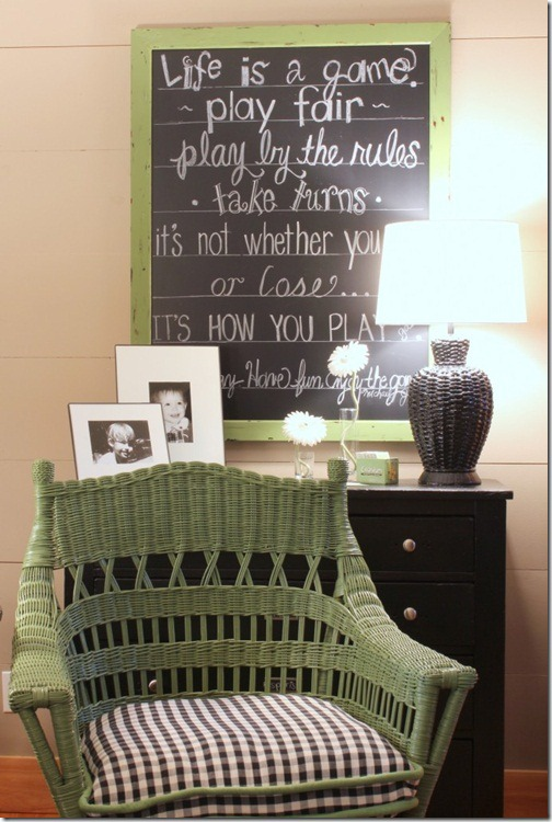 wicker-chair-and-chalkboard-in-playroom-686x1024
