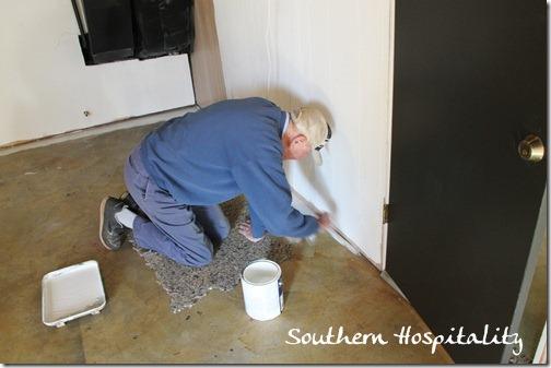 Dad painting floor