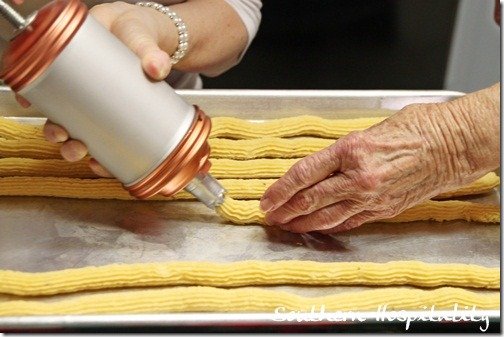 pressing out the cheese straws