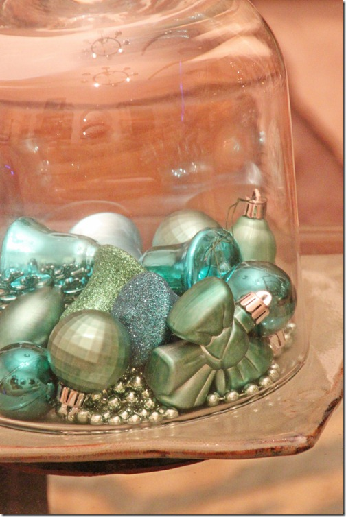 turquoise ornaments under glass