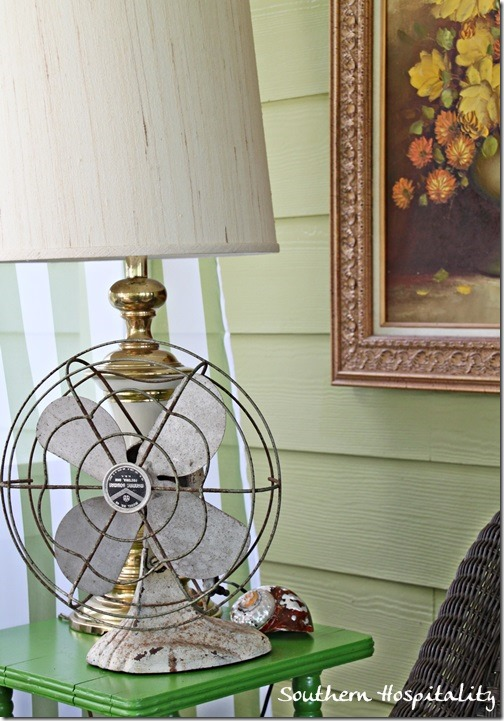 brass lamp and vintage fan
