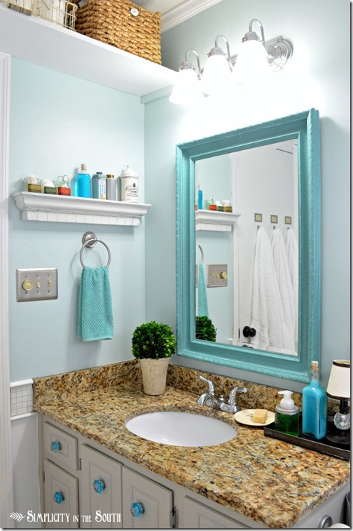guest-bathroom-with-turquoise-mirror
