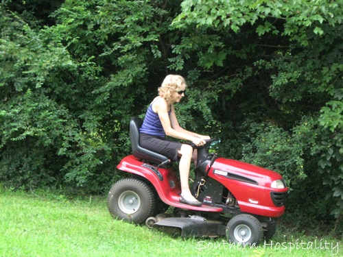 Naked woman on riding lawnmower reserve