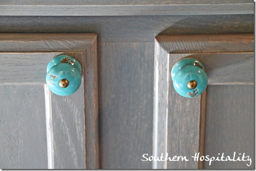 Adding Pretty Knobs on the Laundry Room Cabinet - Southern Hospitality
