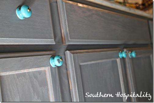 adding pretty knobs on the laundry room cabinet southern