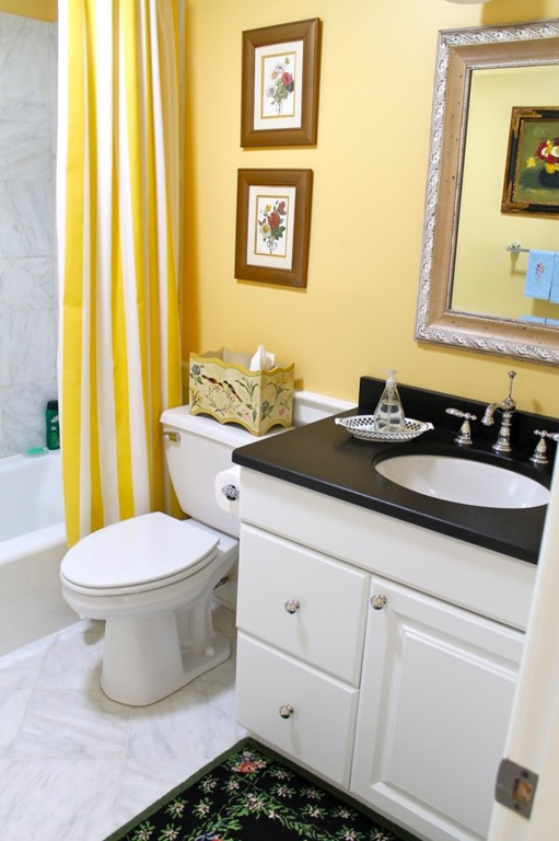 Superb The guest bath with marble floors and that yellow and white striped curtain is so happy