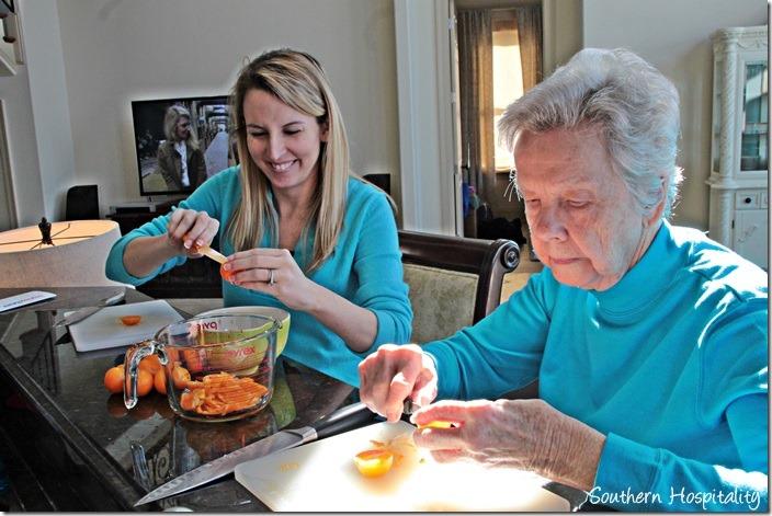 cutting up oranges