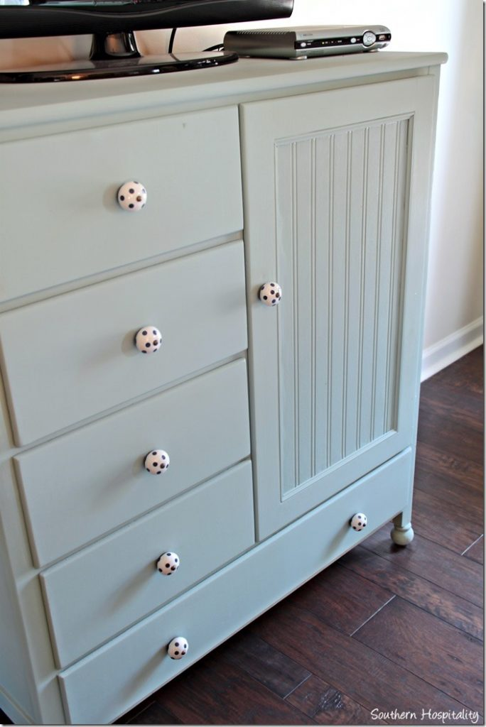 Good This is a dresser I found at an antique mall that I repurposed for my entertainment center in my bedroom a few years ago Adding beadboard wallpaper to the