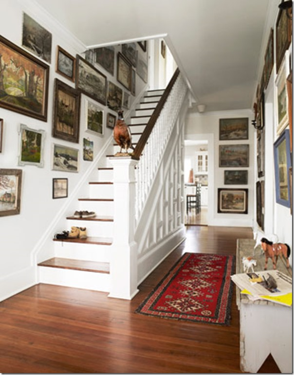 This Hallway Has A Definite Farmhouse Feel With White Woodwork And Walls Dark Flooring Casual Antique Runner The Eclectic Mix Of Gallery Wall