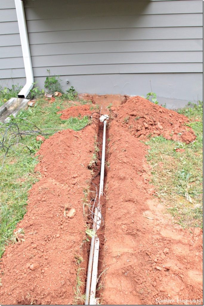 irrigation pipes going to garage