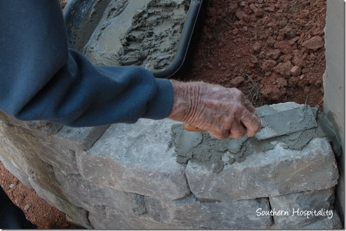 adding mortar to top stones