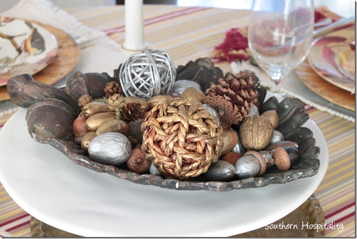 metal bowl of acorns