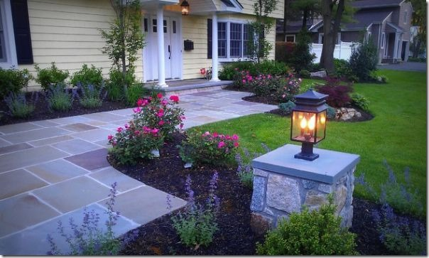stone driveway and pillar with lighting