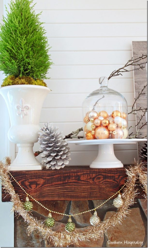 mantel with urns and topiaries