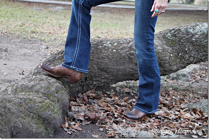 Women wearing cowboy boots and jeans
