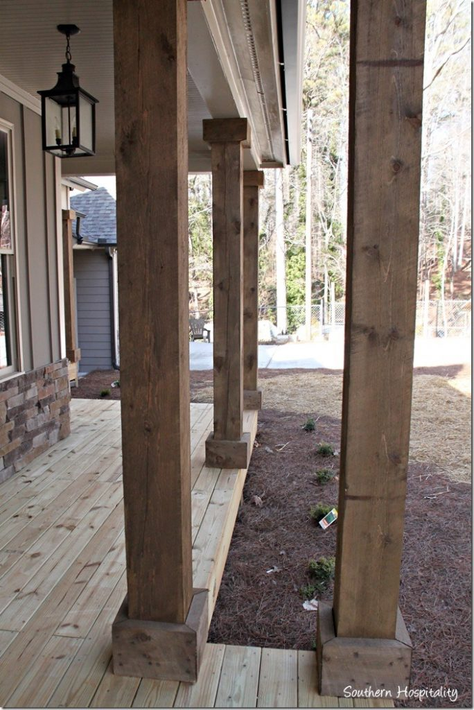 Ruby moved in the lake cottage southern hospitality for Rustic porch columns