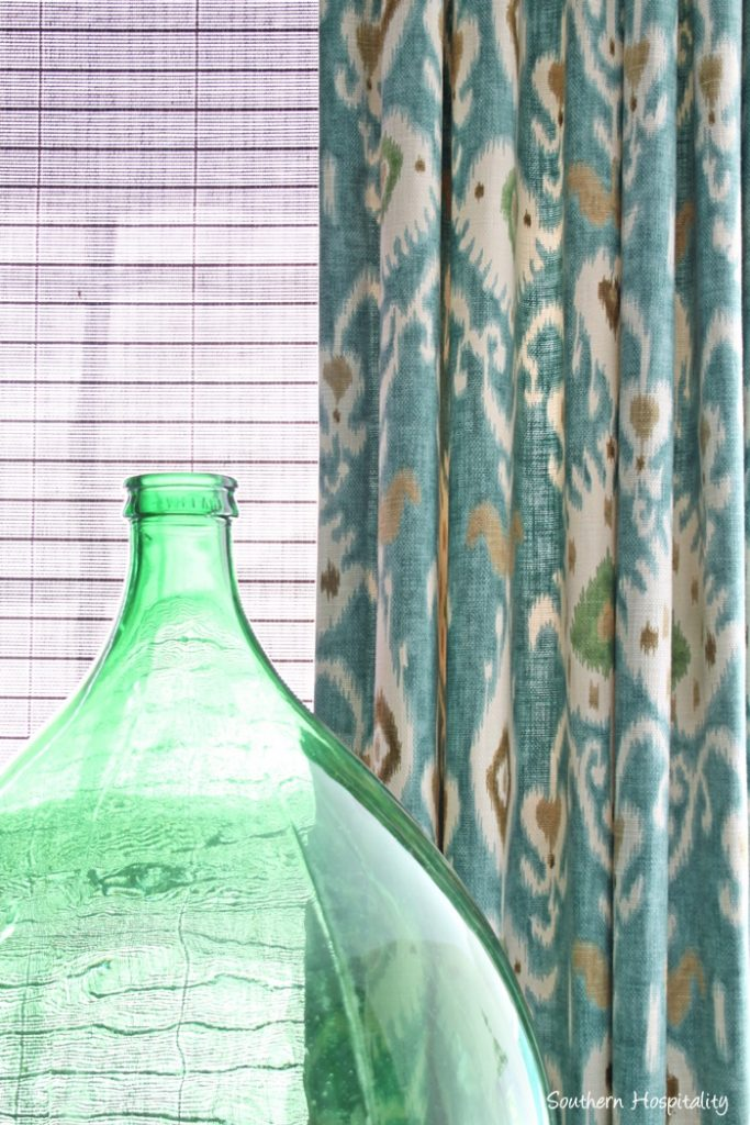 green wine bottle and ikat drapes