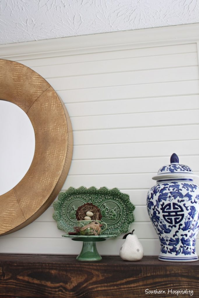 mantel with gold mirror