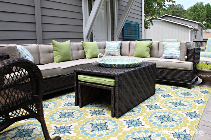 Lovely patio sectional and rug