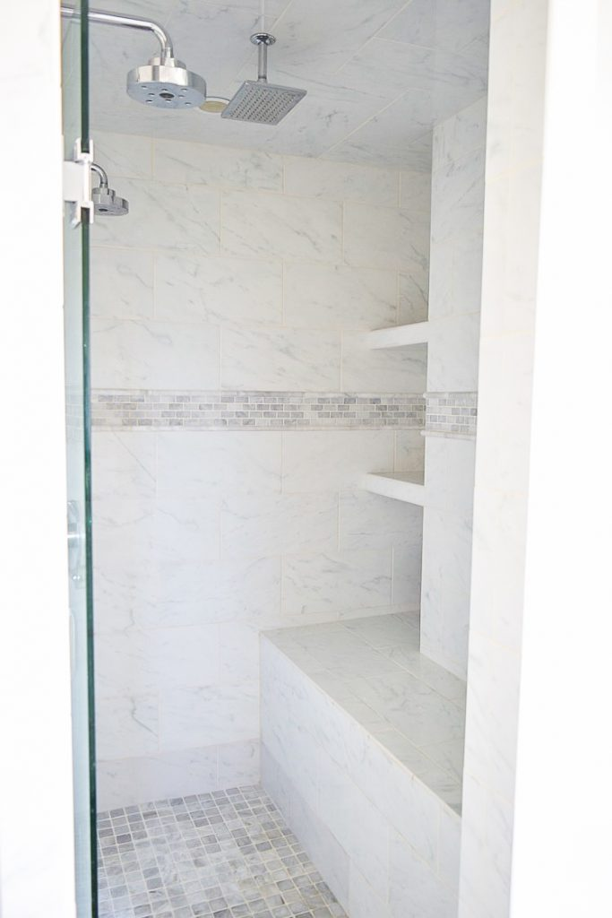 Simple white carrara marble shower