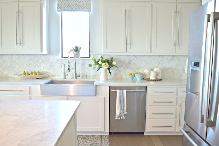 white-kitchen-farmhouse-stainless-sink-commercial-faucet-shaker-doors-carrara-marble