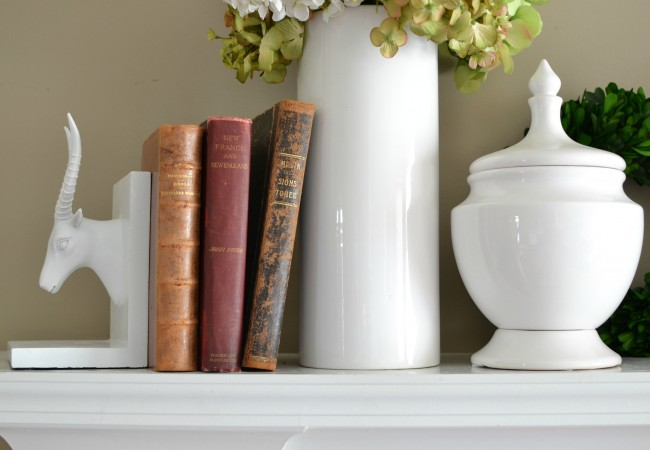 Late Summer Mantel with antique books and white ware