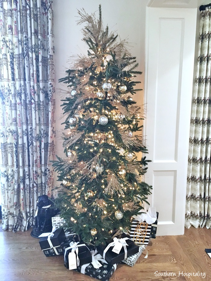 Christmas tree with white, gold, and black wrapped gifts in Atlanta showhouse 2016