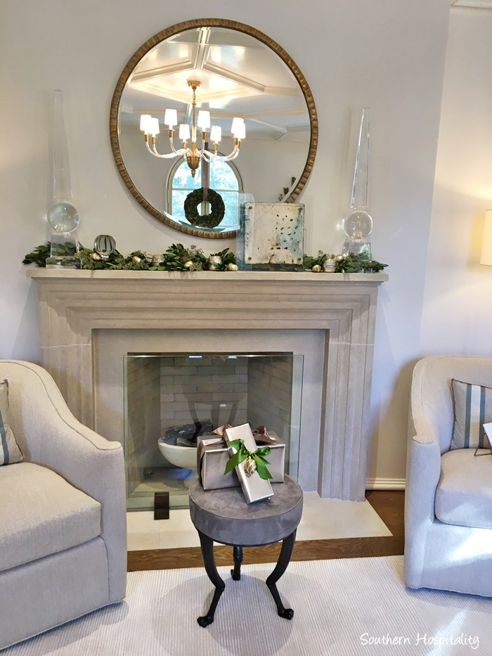 Elegant Christmas decor on stone fireplace mantel in Atlanta showhouse 2016