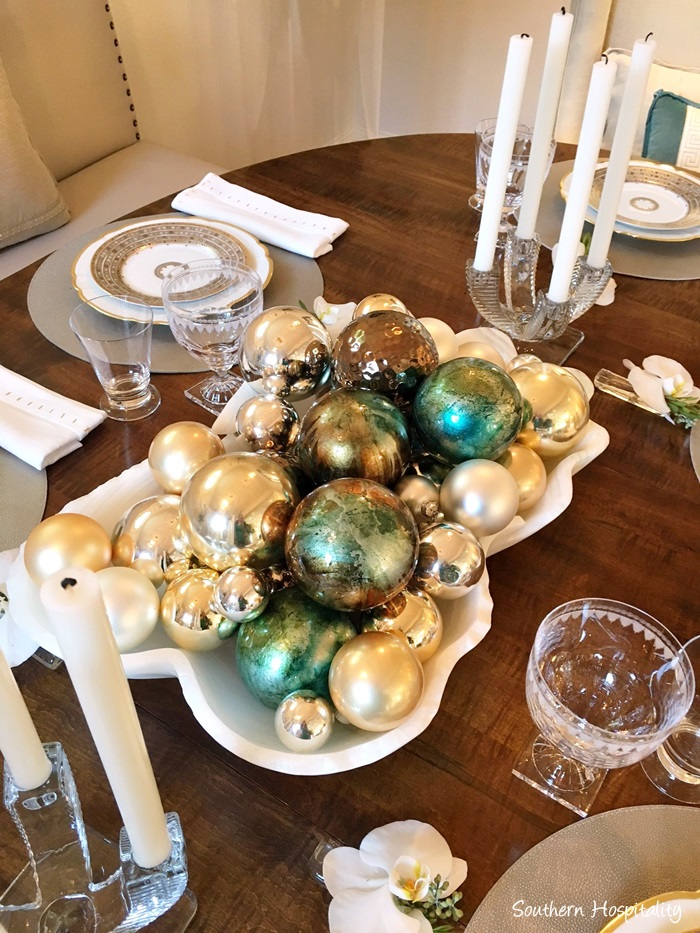 Dramatic bowl of gold and aqua ornaments in Christmas decorated Atlanta showhouse 2016