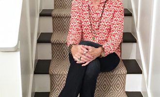 Fashion over 50:  Flared Jeans and Coral Blouse