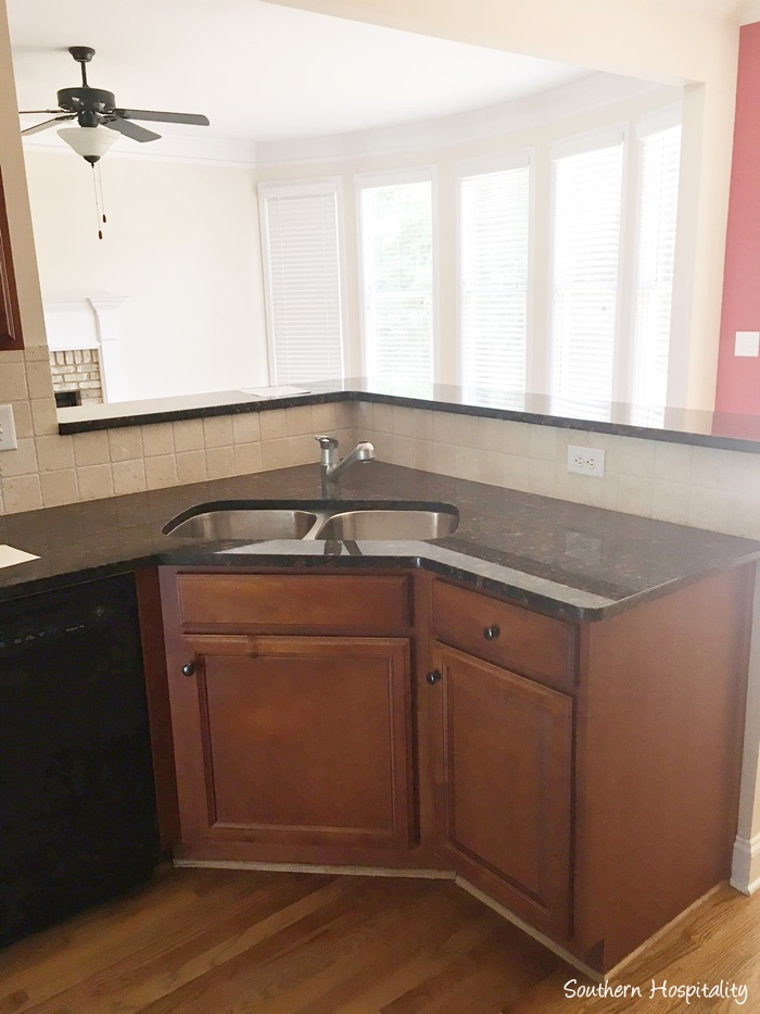 Luxury Kitchen sink peninsula looking towards the den Probably down the road we will redo the backsplash and possibly the granite I love my big single sink and