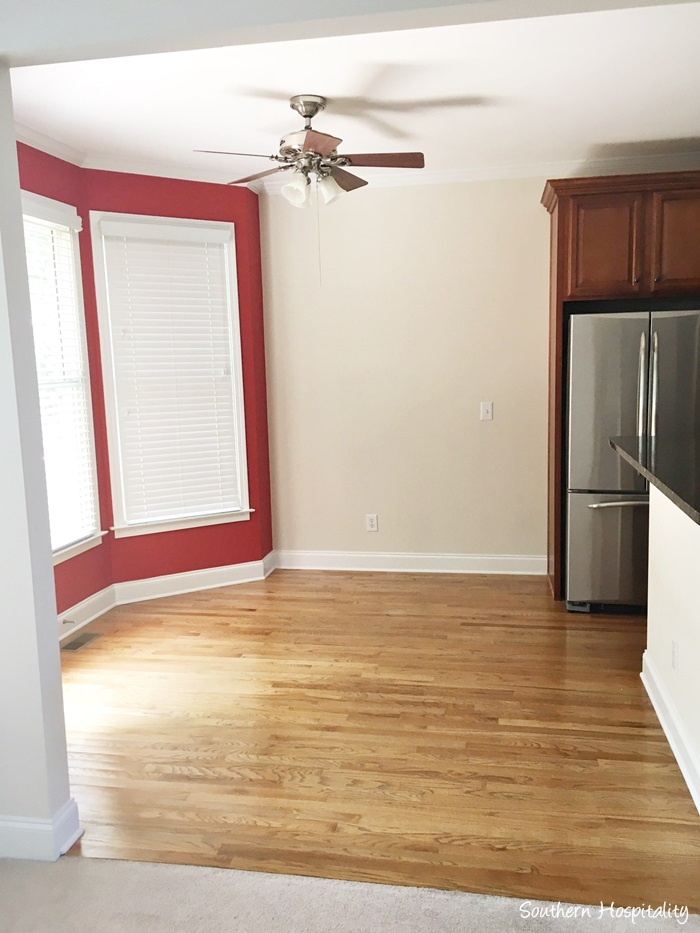 Stunning Den to kitchen That red paint will go That wall by the fridge is just screaming for something so I um still thinking that over