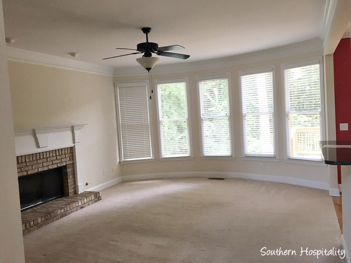 Amazing Den space with fireplace Love this curved bank of windows First project in this house we have already had all this carpet removed into the guest room and