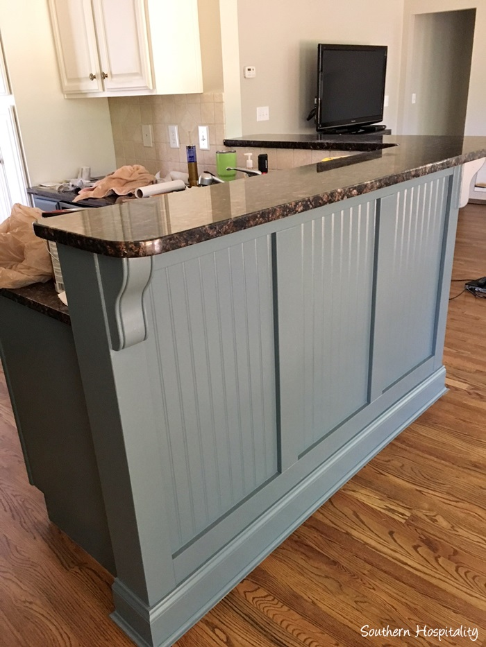 Cute And here us the bar all finished and painted We just love it It us so striking when you walk in the door and now it doesn ut feel so boring and unfinished