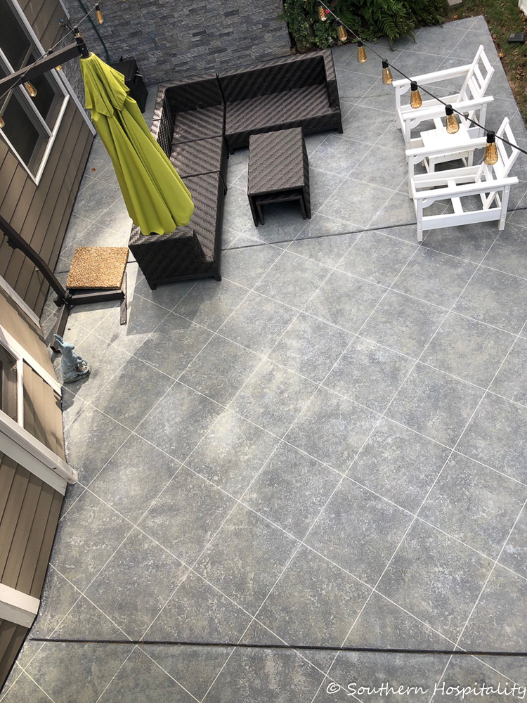 Create a tile look on concrete patio using tape and stone finish paint.